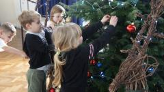 Young children decorating Christmas Tree
