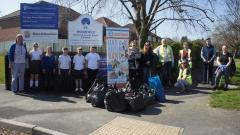 Litter pick group of students and community volunteers with all the rubbish