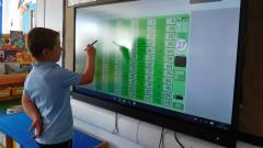 Student using smart board
