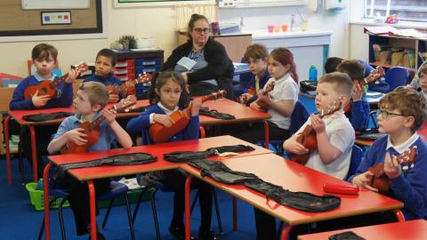 Whole class playing the ukulele