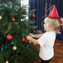 Young child decorating Christmas Tree